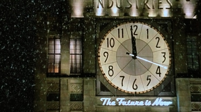 "the clock on the Hudsucker building in the snow in The Hudsucker Proxy, with the words ""The Future is Now"""